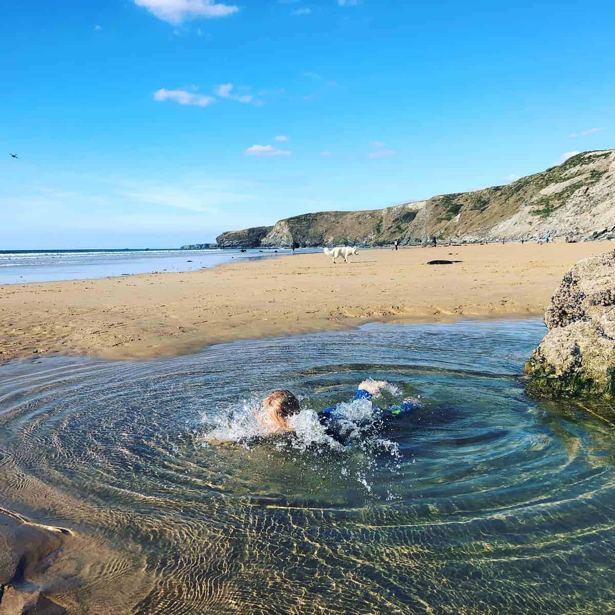 girl diving in rockpool