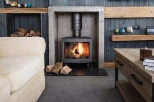 Log burner, lounge, Whipsiderry Beach, Watergate Bay, Bull Pen, Lower Trewince Farm, Cornwall, Self-catering family house, Family Surf Co. Family Surfing Holiday